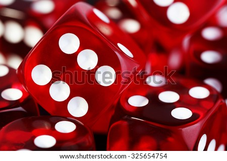 closeup of many red transparent dices - stock photo
