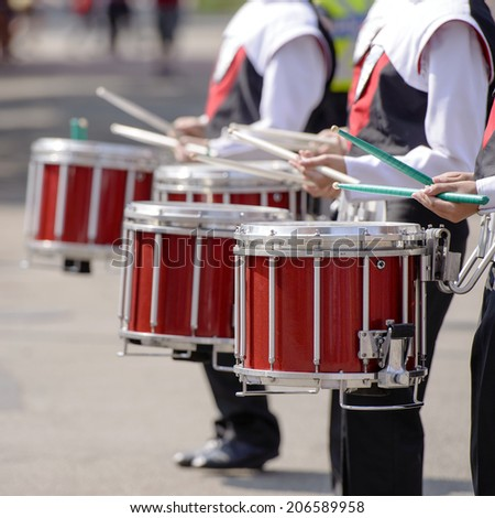 Closeup of marching band drummers marching - stock photo