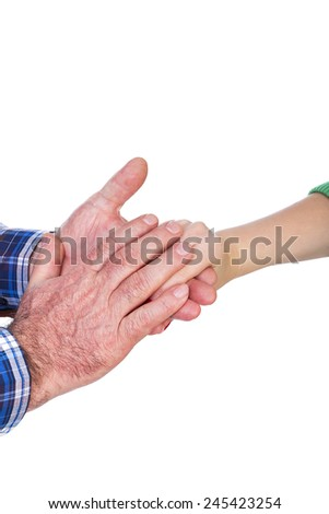 Closeup of mature man hands holding his daughter hand, care concept, over white background - stock photo