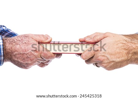 Closeup of mature man�´s hand giving a book to his son,conceptual image, over white background  - stock photo