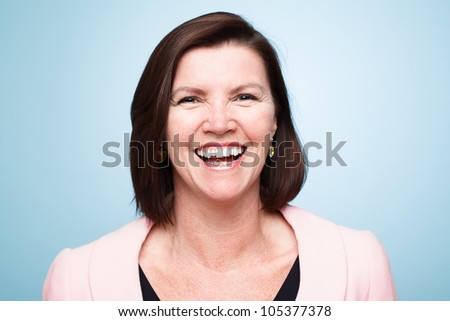 closeup of mature woman smiling - stock photo