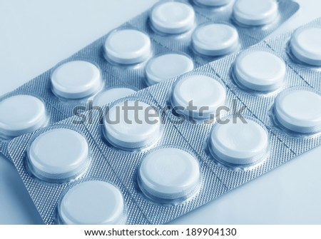 Closeup of medical tablets in vacuum plastic packing