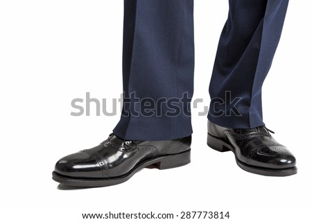 Closeup of Men's Stylish Semi-Brogue Oxford Shoes on a Standing Straight Man. Against White. Horizontal Image