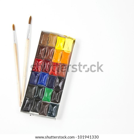 Closeup of messy, used water-color paint-box - stock photo