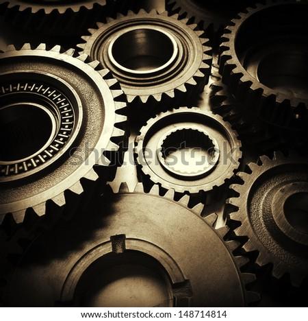 Closeup of metal cog gears - stock photo