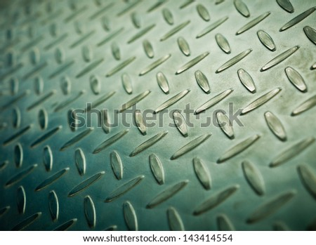 Closeup of metal diamond plate, texture background - stock photo