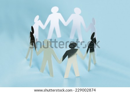 Closeup of metal team representing unity isolated over blue background - stock photo