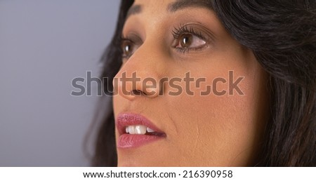 Closeup of Mexican looking away - stock photo