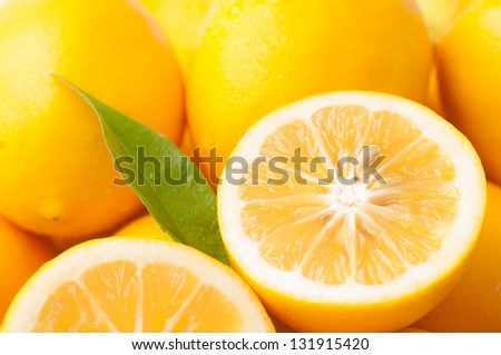 Closeup of Meyer Lemons, a Variety Crossed Between a Mandarin or an Orange and a Regular Lemon to make a sweeter lemon.  Horizontal - stock photo