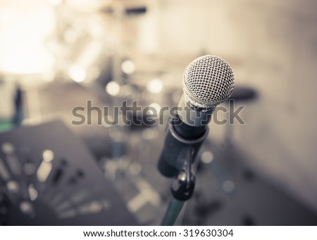 Closeup of microphone in music studio blurred background,vintage tone style - stock photo
