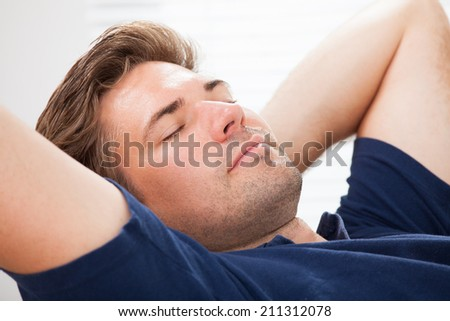 Closeup of mid adult man sleeping at home - stock photo