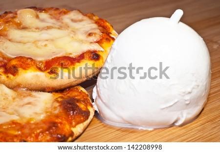 closeup of mini pizza with mozzarella - stock photo