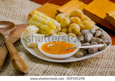 Closeup of mixed white platter with typical latin fried foods. abbas, cheese and salsa bowl delicately arranged rustic setting. - stock photo
