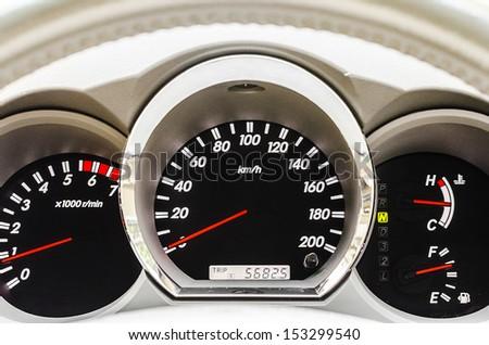 Closeup of modern car illuminated dashboard - stock photo