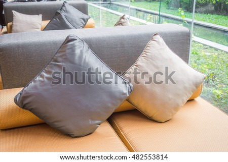 Closeup of modern furniture with pillows