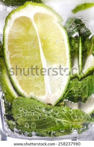 Closeup of mojito coctail in a transperant glass. - stock photo