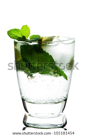 Closeup of Mojito with limes and mint on White background - stock photo