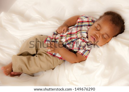 Closeup of 6 Month Old Little Baby African American Boy Sleeping - stock photo