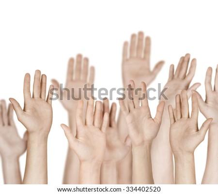Closeup of multiethnic men and women raising hands  - stock photo