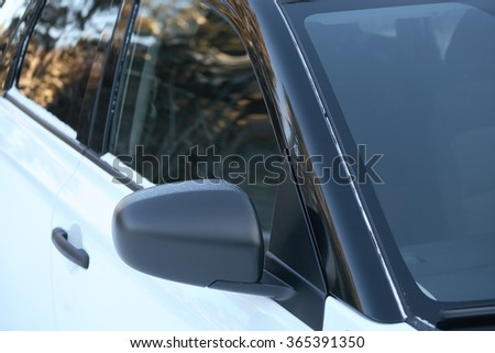 Closeup of new modern black and white car as background