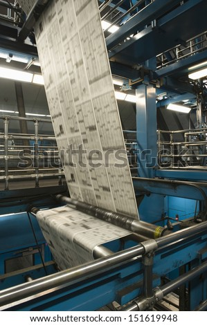 Closeup of newspaper production and printing process - stock photo