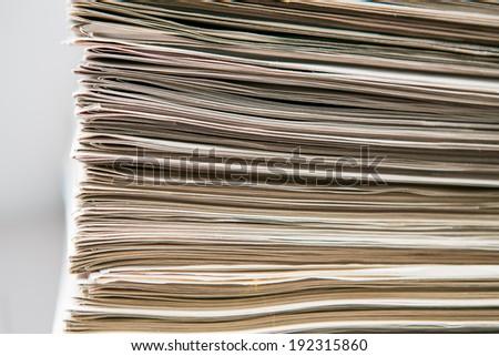 Closeup of newspapers - stock photo