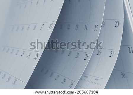 Closeup of numbers on calendar pages - stock photo