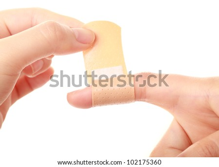 Closeup of of woman's hands with band-aid, on white background - stock photo