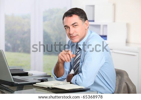 Closeup of office worker in the office - stock photo