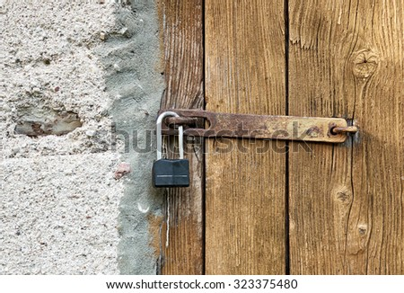 closeup of old closed doors  - stock photo