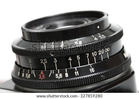 Closeup of old film camera lens. - stock photo