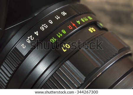 Closeup of old film camera lens. Shallow depth of field. - stock photo