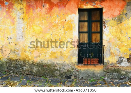 Closeup of old grunge window at Colonia, Uruguay. Facade of colonial house.