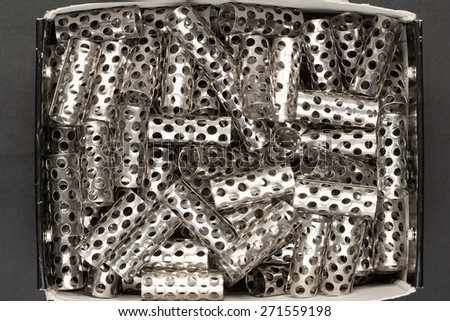 Closeup of Old Hair Rollers in a Box - stock photo