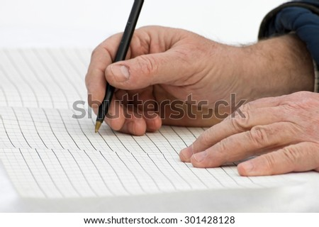 closeup of old hands writing on a document - stock photo