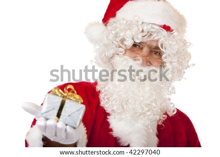 Closeup of old happy Santa Claus holding a Christmas present in his hand. Isolated on white.