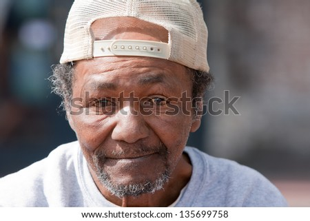 Closeup of old homeless African American Man outdoors - stock photo