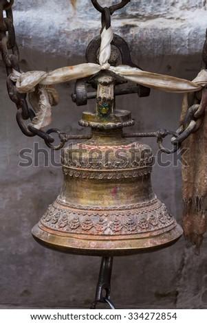 Closeup of old Nepalese Bronze temple bell in Kathmandu, Nepal - stock photo