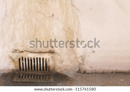 Closeup of old rusty dirty water drain - stock photo