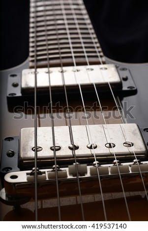 Closeup of old six-string electric guitar. Detail, selective focus.