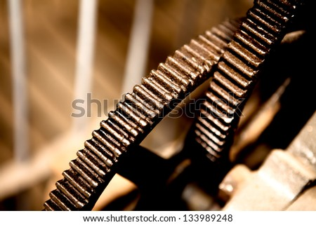 Closeup of old style cogs - stock photo