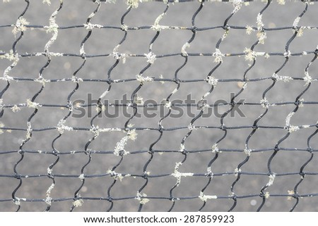 Closeup of old vintage tennis net background