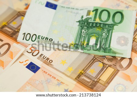 Closeup of one hundred euro banknote on money background - stock photo