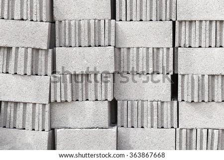 Closeup of openwork concrete blocks. - stock photo
