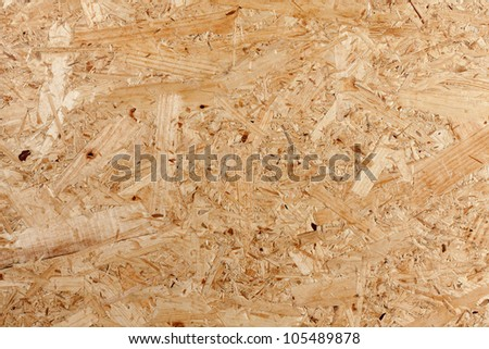 Closeup of oriented strand board,construction material made of recycled wood - stock photo