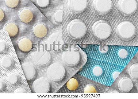 Closeup of packs of pills full frame
