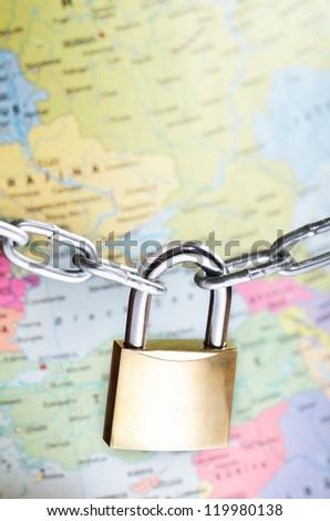 Closeup of padlock on world map representing global security concept - stock photo