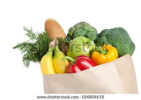 Closeup of paper bag with healthy food, isolated on white
