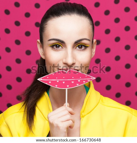 Closeup of party girl with lips sign - stock photo