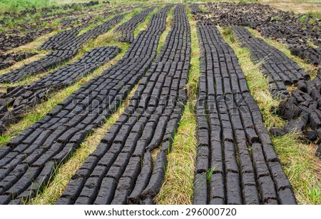 closeup of peat bog field ready for cultivation in Ireland - stock photo